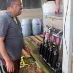 Mohanan overseeing the bottling process